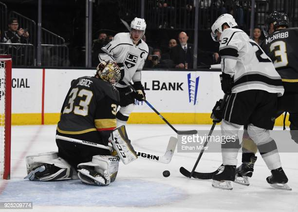 Maxime Lagace of the Vegas Golden Knights defends the net as Dustin Brown of the Los Angeles Kings tries to put in a rebound in the third period of...