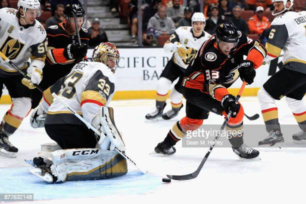 Maxime Lagace of the Vegas Golden Knights defnds against a shot on goal by Jakob Silfverberg of the Anaheim Ducks during the first period of a game...