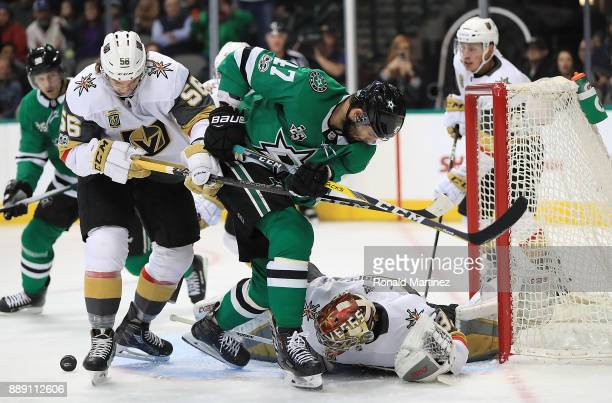 Maxime Lagace of the Vegas Golden Knights makes a save in front of Alexander Radulov of the Dallas Stars in the first period at American Airlines...