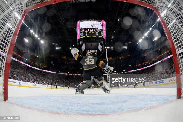Maxime Lagace of the Vegas Golden Knights tends net outside the crease against the New Jersey Devils during the game at TMobile Arena on March 14...