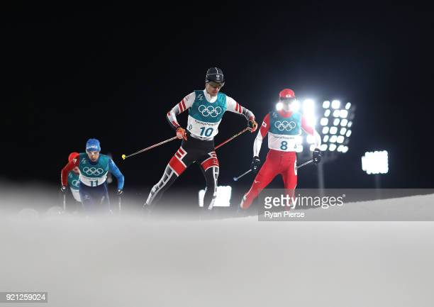 Maxime Laheurte of France and Go Yamamoto of Japan competes during the Nordic Combined Individual Gundersen 10km CrossCountry on day eleven of the...
