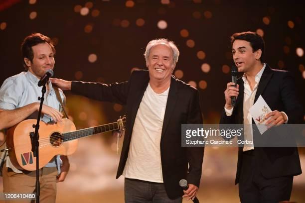 Maxime Le Forestier celebrates after receiving a special honour award next to Vianney and Julian Bugier during the 35th 'Les Victoires De La Musique'...