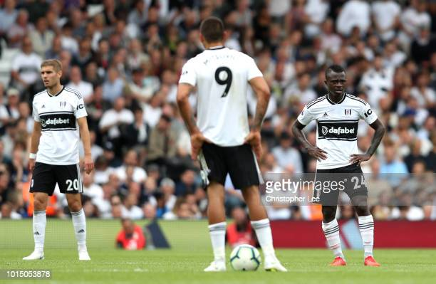 Maxime Le Marchand and Jean Michael Seri of Fulham look dejected after conceding during the Premier League match between Fulham FC and Crystal Palace...