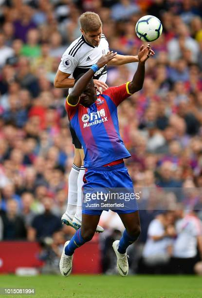Maxime Le Marchand of Fulham and Christian Benteke of Crystal Palace challenge for the ball during the Premier League match between Fulham FC and...