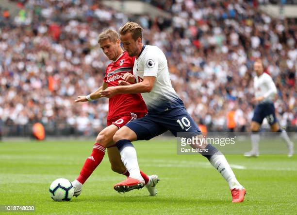 Maxime Le Marchand of Fulham and Harry Kane of Tottenham Hotspur battle for the ball during the Premier League match between Tottenham Hotspur and...
