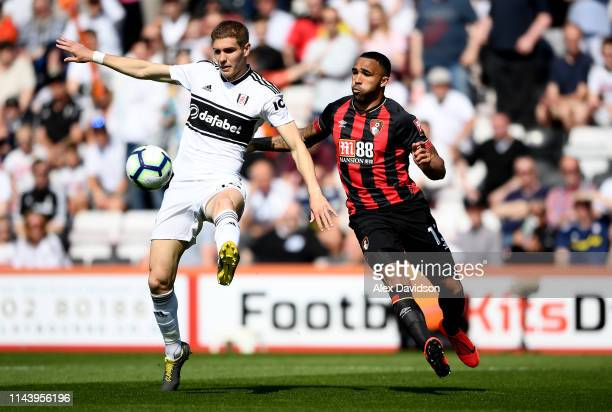 Maxime Le Marchand of Fulham battles for possession with Callum Wilson of AFC Bournemouth during the Premier League match between AFC Bournemouth and...