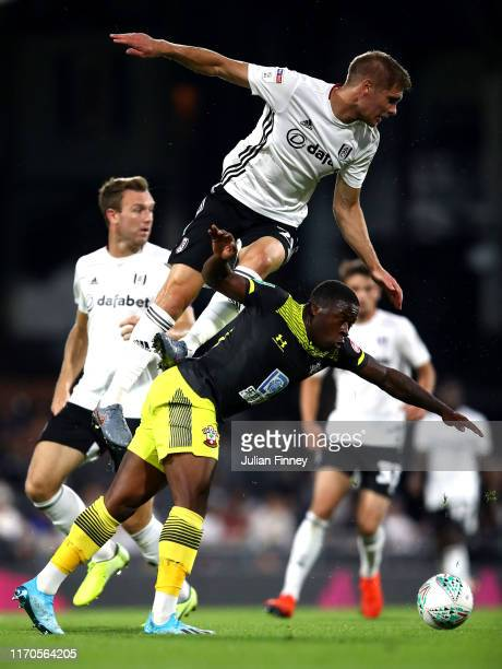 Maxime Le Marchand of Fulham battles for possession with Michael Obafemi of Southampton during the Carabao Cup Second Round match between Fulham and...