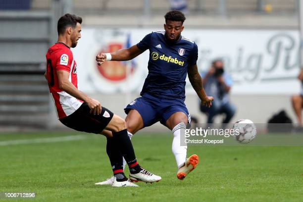 Maxime Le Marchand of Fulham defines against Raul Garcia of Bilbao during the second semi final match between FC Fulham and Athletic Bilbao at...