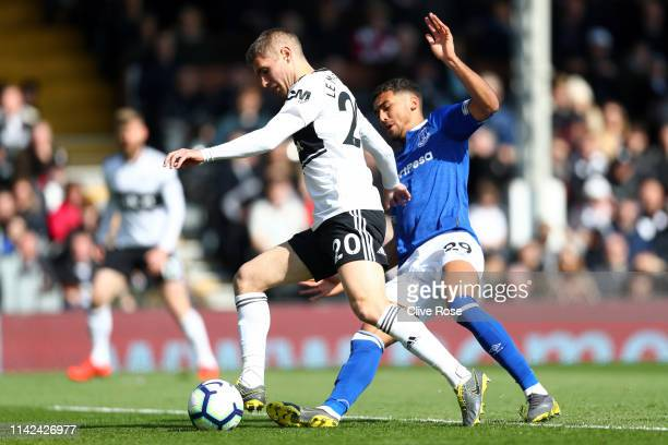 Maxime Le Marchand of Fulham is challenged by Dominic Calvert-Lewin of Everton during the Premier League match between Fulham FC and Everton FC at...
