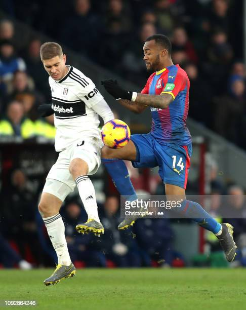 Maxime Le Marchand of Fulham is challenged by Jordan Ayew ofrystal Palace during the Premier League match between Crystal Palace and Fulham FC at...
