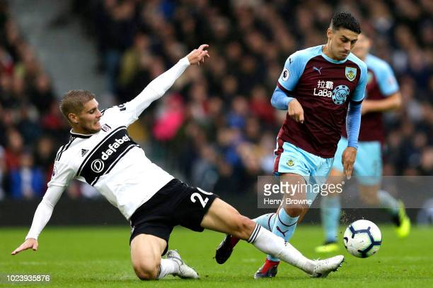 Maxime Le Marchand of Fulham tackles Matthew Lowton of Burnley during the Premier League match between Fulham FC and Burnley FC at Craven Cottage on...
