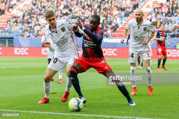Maxime Le Marchand of Nice and Christian Kouakou of Caen during the Ligue 1 match between SM Caen and OGC Nice at Stade Michel D'Ornano on November...