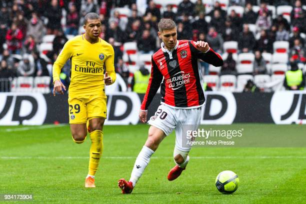 Maxime Le Marchand of Nice and Kylian Mbappe of PSG during the Ligue 1 match between OGC Nice and Paris Saint Germain at Allianz Riviera on March 18...