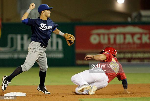 Maxime Lefevre of Team France attempts to turn a double play as Adrian Nieto of Team Spain slides into second base during game 2 of the Qualifying...