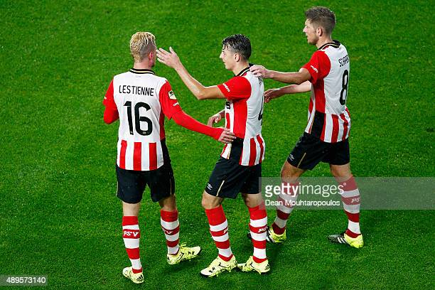 Maxime Lestienne and Stijn Schaars congratulate Santiago Arias of PSV after his cross led to an own goal by Kai Heerings of Cambuur during the KNVB...