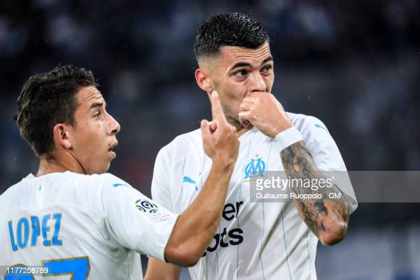 Maxime Lopez and Nemanja Radonjic during the Ligue 1 match between Olympique de Marseille and RC Strasbourg at Stade Velodrome on October 20 2019 in...