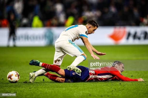 Maxime Lopez of Marseille and Antoine Griezmann of Atletico Madrid battle for the ball during the UEFA Europa League Final between Olympique de...