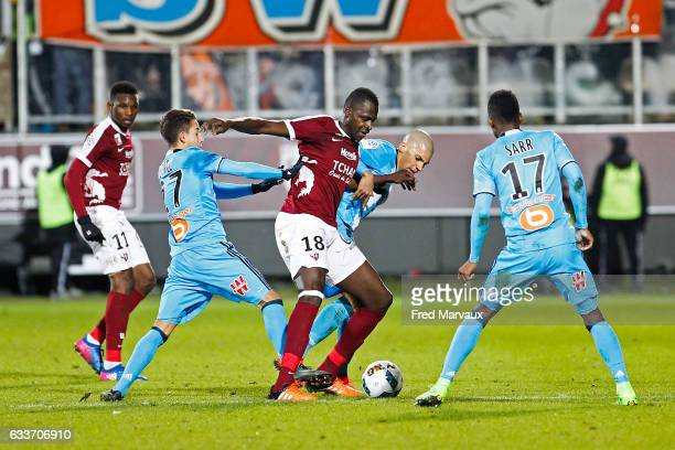 Maxime Lopez of Marseille and Check Diabate of Metz during the Ligue 1 match between FC Metz and Olympique de Marseille at Stade SaintSymphorien on...