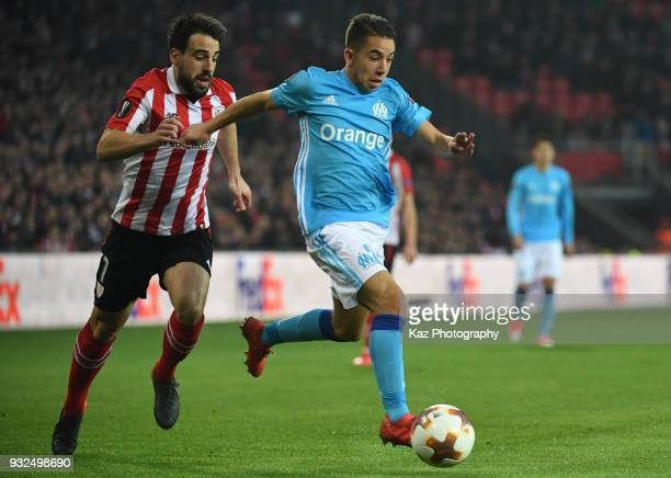Maxime Lopez of Marseille beats Mikel Rico of Athletic Bilbao during UEFA Europa League Round of 16 2nd leg match between Athletic Bilbao and...