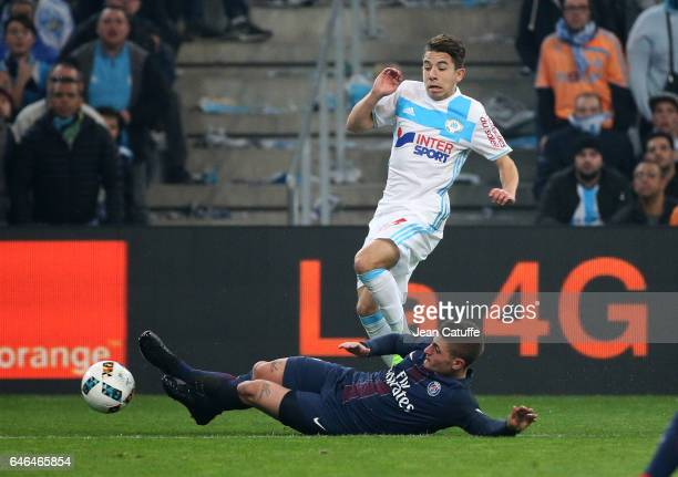Maxime Lopez of OM and Marco Verratti of PSG in action during the French Ligue 1 match between Olympique de Marseille and Paris Saint Germain at...