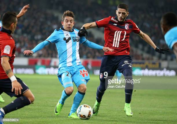 Maxime Lopez of OM and Yassine Benzia of Lille in action during the French Ligue 1 match between Lille OSC and Olympique de Marseille at Stade...