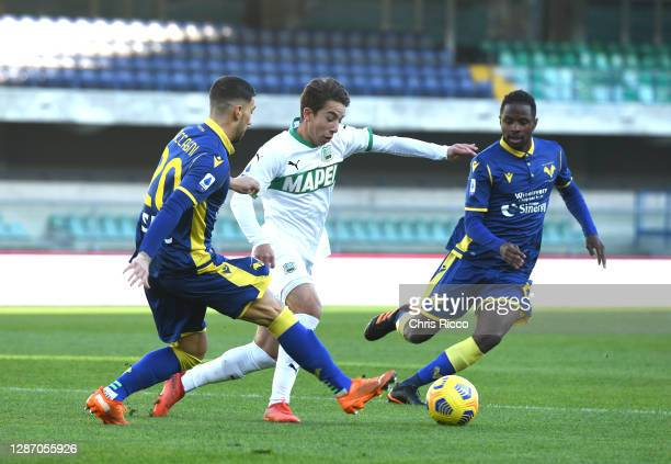 Maxime Lopez of Sassuolo is challenged by Mattia Zaccagni and Adrien Tameze of Hellas Verona F.C. During the Serie A match between Hellas Verona FC...