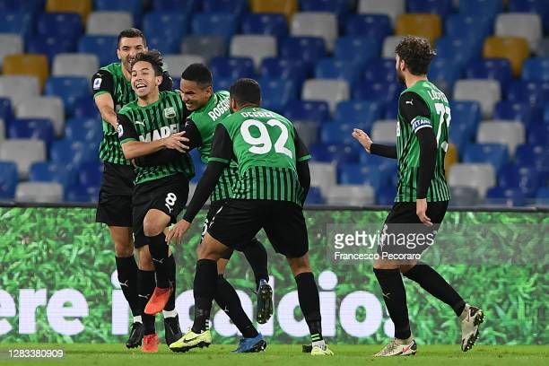 Maxime Lopez of US Sassuolo celebrates after scoring the 0-2 goal during the Serie A match between SSC Napoli and US Sassuolo at Stadio San Paolo on...
