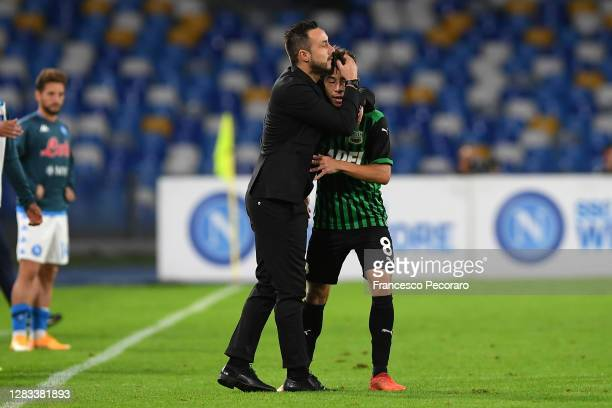 Maxime Lopez of US Sassuolo celebrates after scoring the 0-2 goal with his coach Roberto De Zerbi during the Serie A match between SSC Napoli and US...