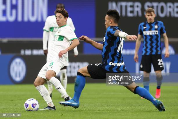 Maxime Lopez of US Sassuolo is closed down by Lautaro Martinez of Internazionale during the Serie A match between FC Internazionale and US Sassuolo...