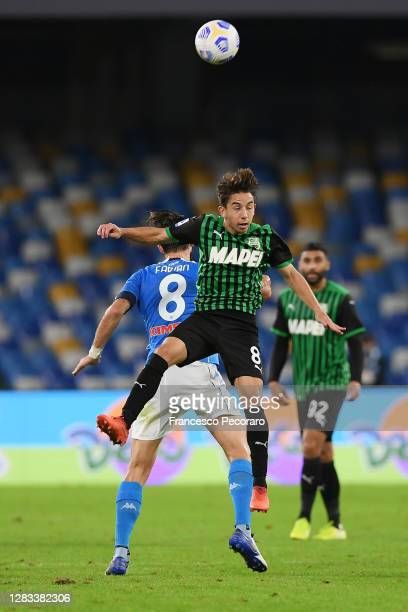Maxime Lopez of US Sassuolo vies with Fabian Ruiz of SSC Napoli during the Serie A match between SSC Napoli and US Sassuolo at Stadio San Paolo on...