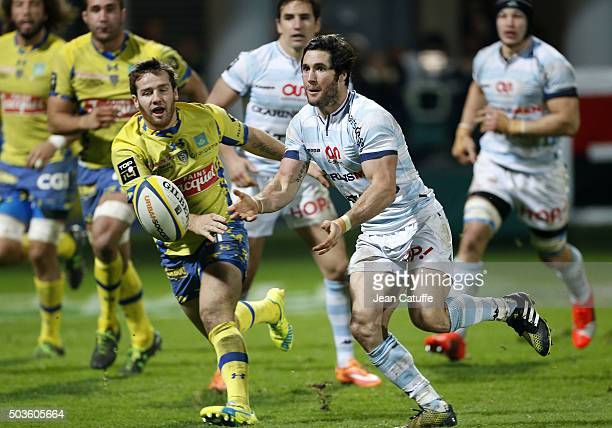 Maxime Machenaud of Racing 92 and Camille Lopez of ASM Clermont in action during the Top 14 rugby match between ASM Clermont Auvergne and Racing 92...