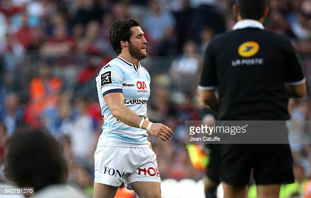 Maxime Machenaud of Racing 92 leaves the pitch after receiving a red card during the Final Top 14 between Toulon and Racing 92 at Camp Nou on June...