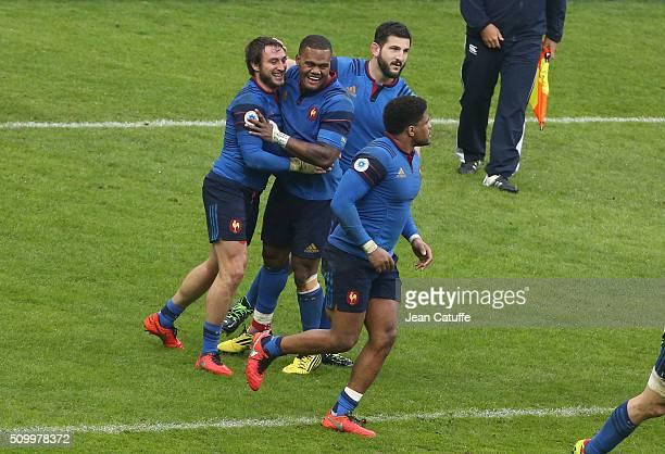 Maxime Medard of France celebrates scoring the winning try with teammates Virimi Vakatawa Loann Goujon during the RBS 6 Nations match between France...