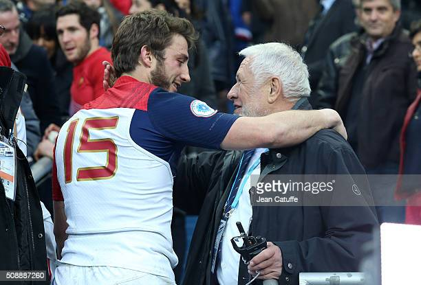 Maxime Medard of France greets FFR chief of security Robert Broussard following the RBS 6 Nations match between France and Italy at Stade de France...