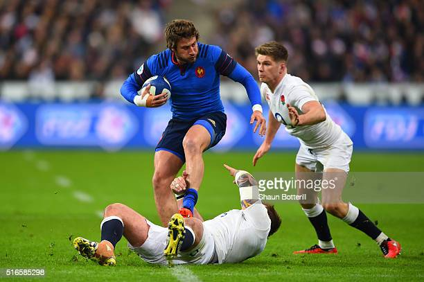 Maxime Medard of France is tackled by Joe Marler and Owen Farrell of England during the RBS Six Nations match between France and England at the Stade...