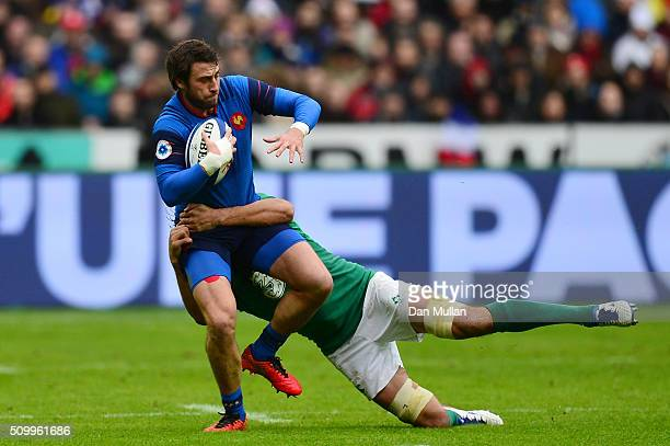Maxime Medard of France is tackled Mike McCarthy of Ireland during the RBS Six Nations match between France and Ireland at the Stade de France on...