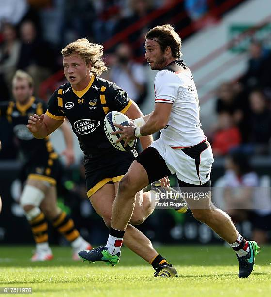 Maxime Medard of Toulouse breaks with the ball during the European Champions Cup match between Toulouse and Wasps at Stade Ernest Wallon on October...