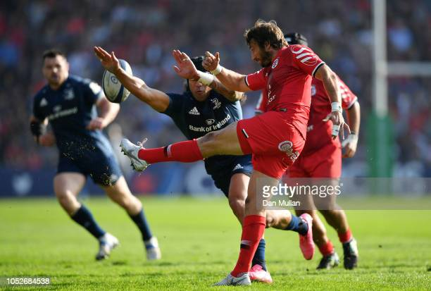 Maxime Medard of Toulouse clears under pressure from Joseph Tomane of Leinster during the Champions Cup match between Toulouse and Leinster Rugby at...