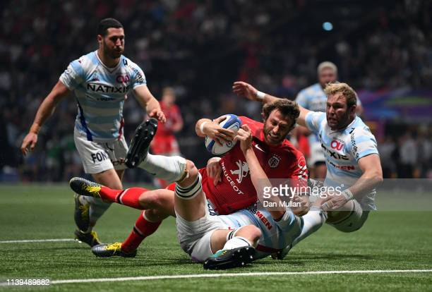 Maxime Medard of Toulouse dives over to score his side's second try during the Heineken Champions Cup Quarter Final match between Racing 92 and...
