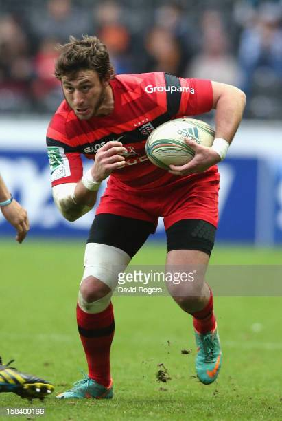 Maxime Medard of Toulouse runs with the ball during the Heineken Cup match between Ospreys and Stade Toulouse at the Liberty Stadium on December 15...