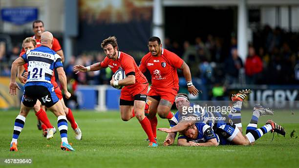 Maxime Medard of Toulouse shakes off a tackle by Henry Thomas of Bath during the European Rugby Champions Cup match between Bath Rugby and Toulouse...