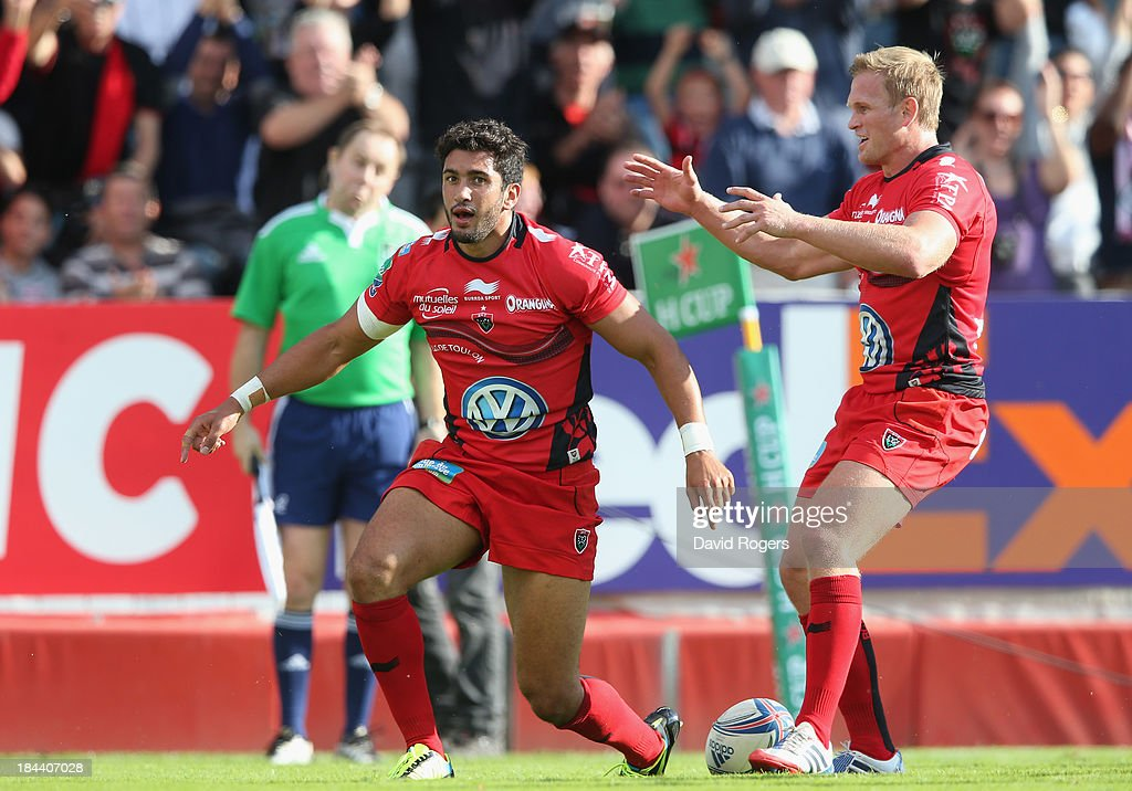 Maxime Mermoz of Toulon (L) celebrates with team mate Michael Claassens after scoring his first try during the Heineken Cup Pool 2 match between Toulon and Glasgow Warriors at the Felix Mayol Stadium on October 13, 2013 in Toulon, France.