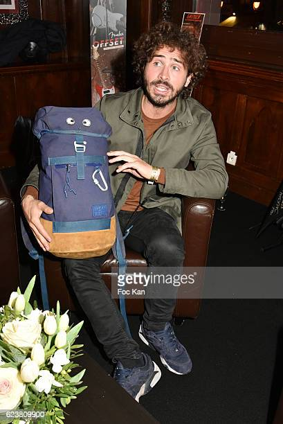 Maxime Musqua pose swith his Backpack called 'Jacko' from his 'Adventures with Backpack Jacko' travel TV serial during 'Hard Rock Cafe Paris 25th...