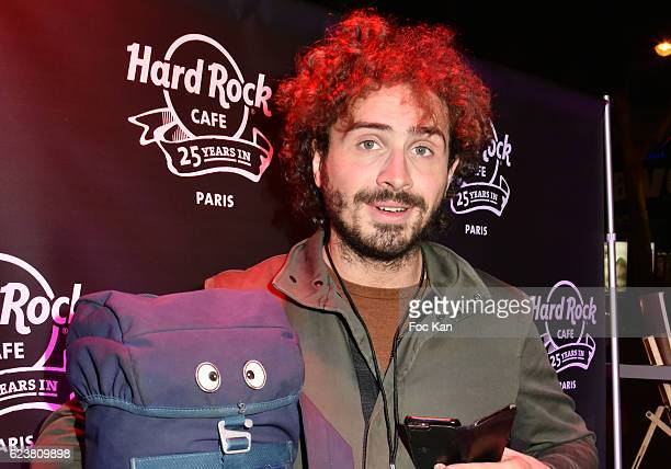 Maxime Musqua poses with his Backpack called 'Jacko' from his 'Adventures with Backpack Jacko' travel TV serial during 'Hard Rock Cafe Paris 25th...