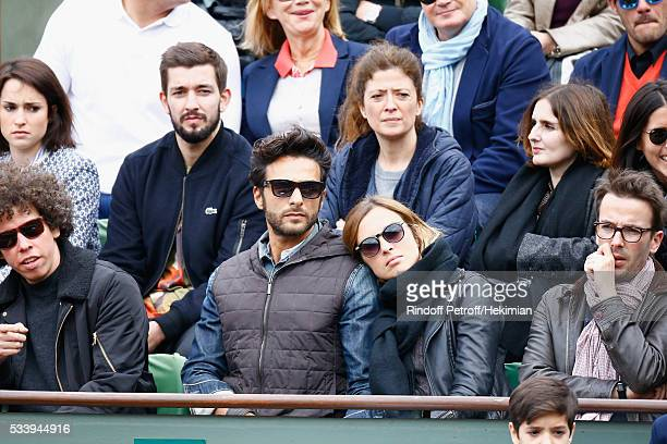 Maxime Nucci and his companion Isabelle Ithurburu attend the 2016 French Tennis Open Day Three at Roland Garros on May 24 2016 in Paris France
