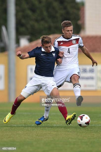 Maxime Pelican of France clashes with Paul Grauschopf of Germany during the International Friendly match between U16 France and U16 Germany at Stade...