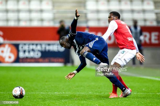 Maxime POUNDJE of Bordeaux and Dereck KUTSEA of Reims during the Ligue 1 match between Reims and Girondins Bordeaux at Stade Auguste Delaune on May...