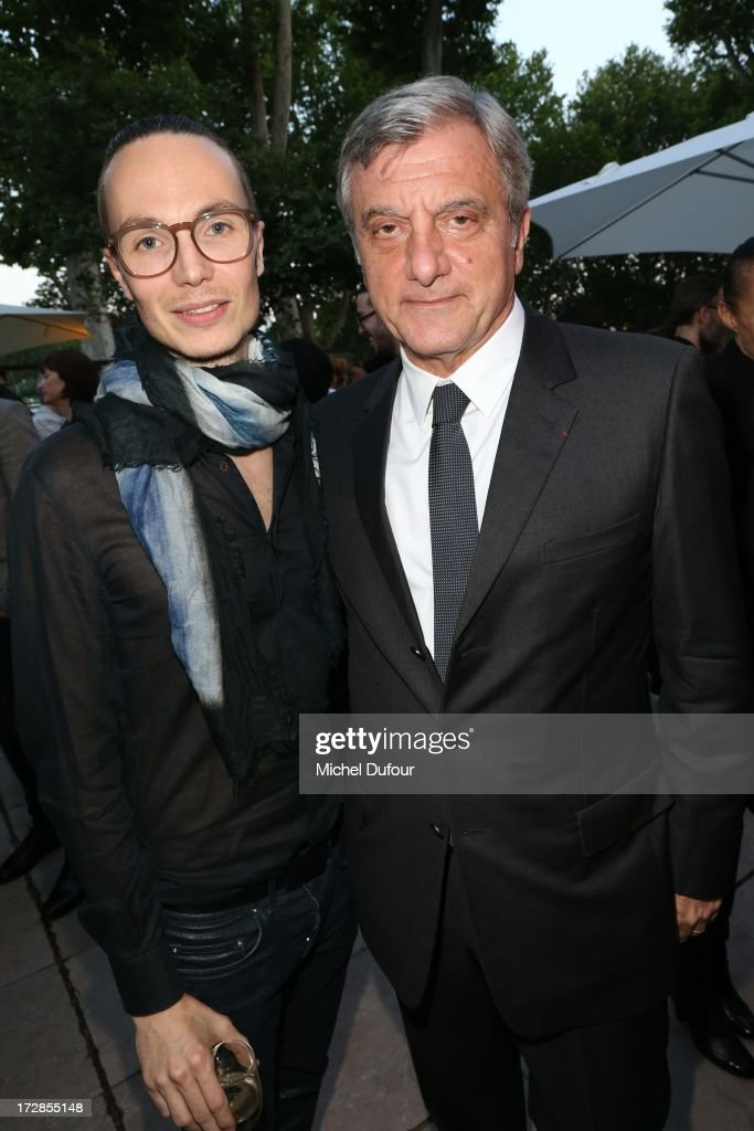 Maxime Simoens and Sidney Toledano (R) attend Chambre Syndicale de la Haute Couture cocktail party at Palais De Tokyo on July 4, 2013 in Paris, France.