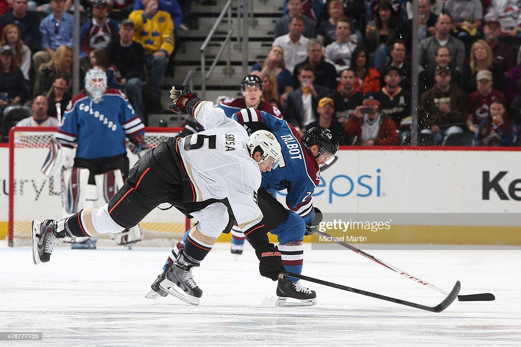 Maxime Talbot #25 of the Colorado Avalanche battles for position against Luca Sbisa #5 of the Anaheim Ducks at the Pepsi Center on March 14, 2014 in Denver, Colorado.