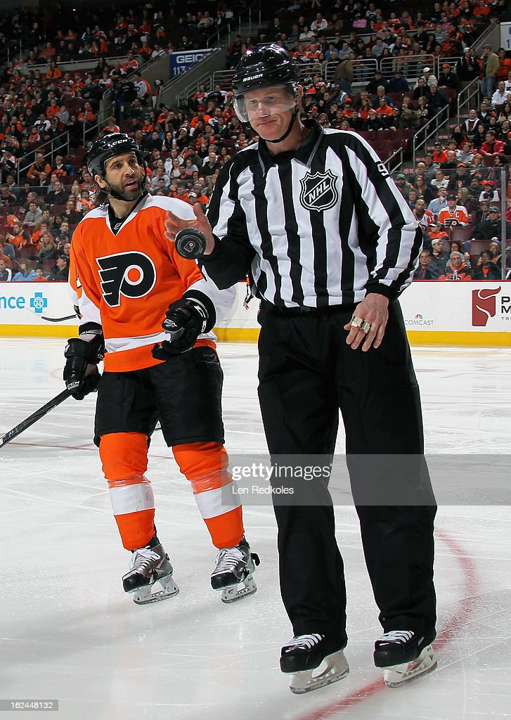 Maxime Talbot #25 of the Philadelphia Flyers chats with linesman Jean Morin #97 during a stoppage in play against the Winnipeg Jets on February 23, 2013 at the Wells Fargo Center in Philadelphia, Pennsylvania. The Flyers went on to defeat the Jets 5-3.